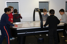 Students enjoy a well-mannered game of Air Hockey
