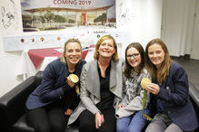 Parents and children enjoy meeting the Hockey Gold medallists