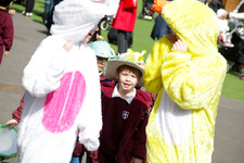 Nursery children go on an egg hunt and parade colourful Easter bonnets
