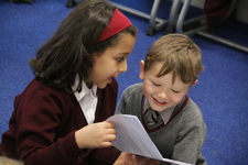 Year 4 share exciting Christmas readings with Year 1